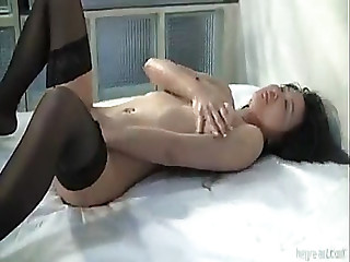 Sexy oriental beauty in nylons plays with herself