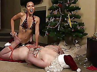 Santa At The Leniency Of Oriental Femdom With Belt On
