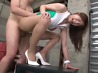 Asian Queen With White Stilettos While Enjoying A Brief Moment