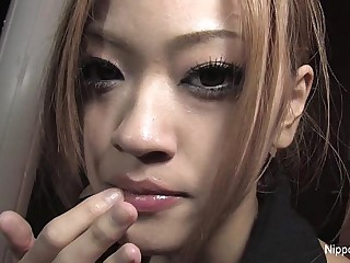 Japanese teen plays with cum