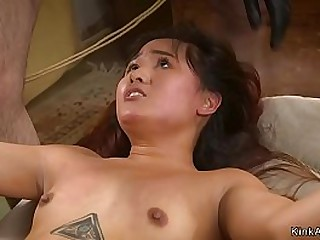 Petite Asian slut is tight tied with ass sticked in the air and big cock master rough bangs her from behind