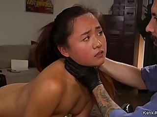 Petite Asian slut is tied in doggy position and gets pussy rough fucked and whipped by master